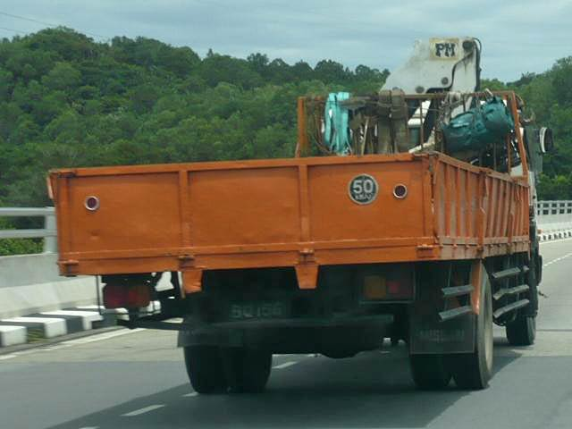 Picture of rear of a Nissan Diesel cargo truck