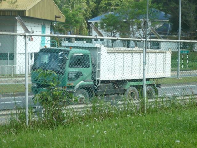 Nissan Diesel bulk dump truck on busy road