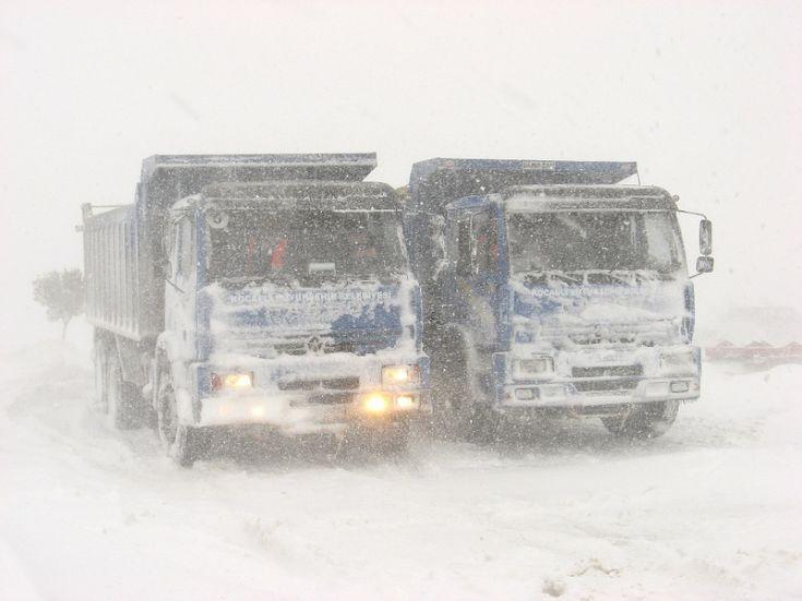 Fargo dump trucks in heavy snow