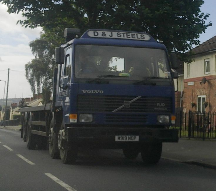 Blue Volvo FL10 on the road