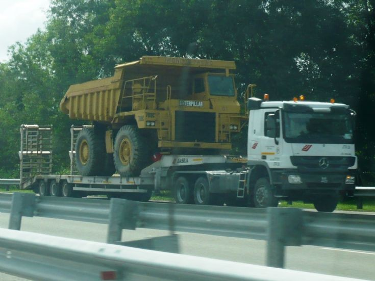 Mercedes Benz Actros  tractor with Caterpillar dump truck