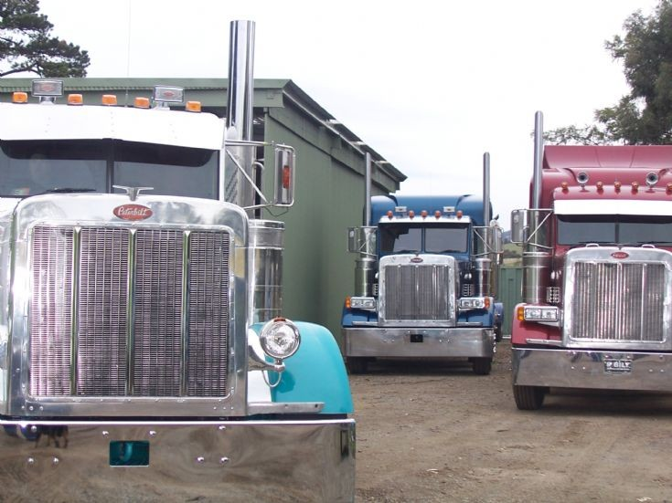 Three Peterbilt Trucks