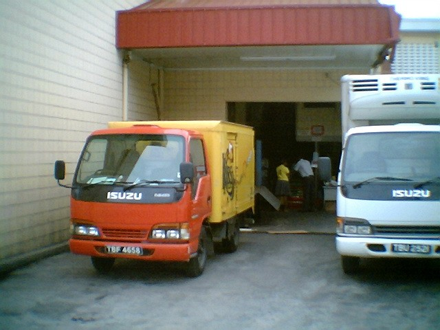 Two Isuzu trucks side by side