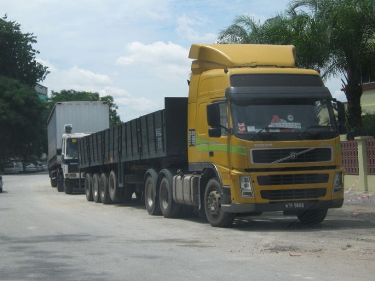 Volvo FM 12 Truck and Trailer with wooden sideboards in Petaling Jaya, Selangor, Malaysia