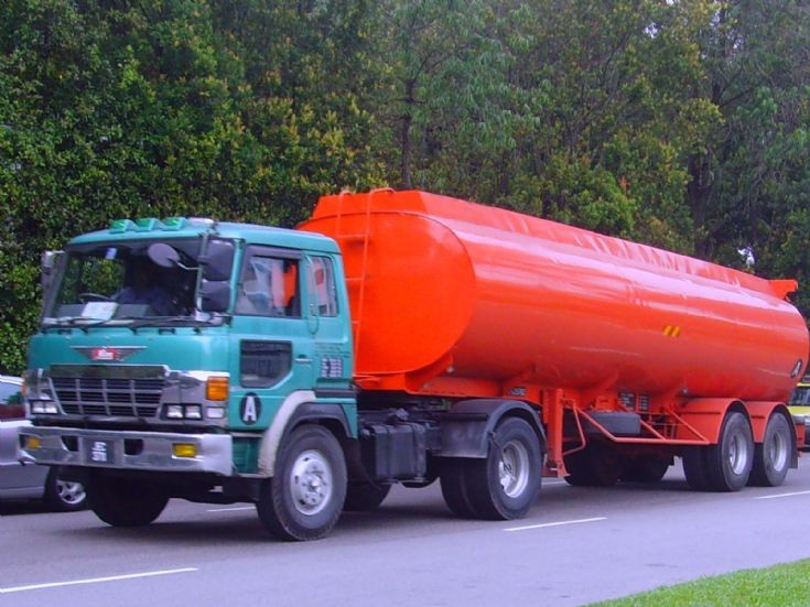 Hino Super Dolphin SH Tractor hauling an Edible Oil Tanker
