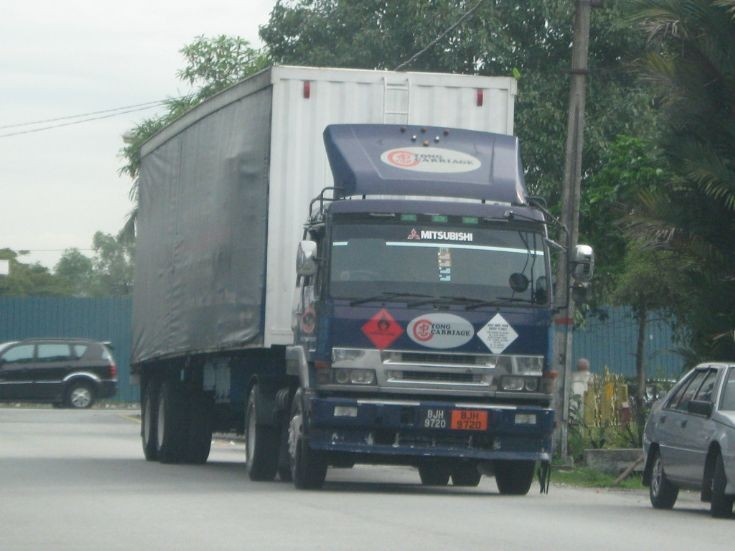 Mitsubishi Fuso Great truck and trailer in Malaysia