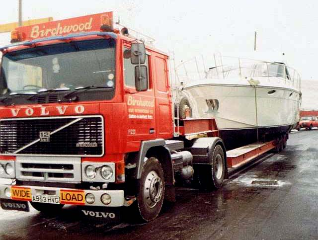 Volvo F12 towing boat