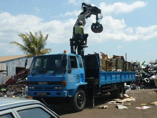 Isuzu FTR cargo truck w Cormach grapple